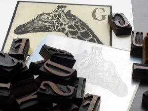 Making your mark: the zinc plates and original wood type used by Derek Chambers for his print G is for Giraffe in his book Ipswich Museum Alphabet